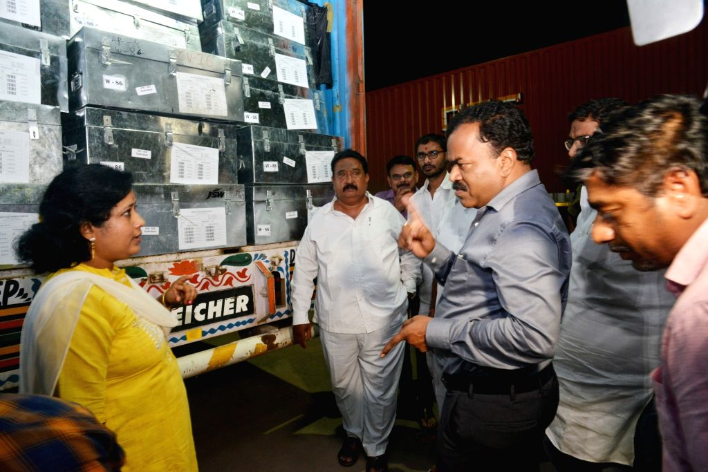 Greater Hyderabad Municipal Corporation (GHMC) commissioner M Dana Kishore instructs a poll official as Electronic Voting Machines (EVM) are being brought to Hyderabad ahead of Telangana ...