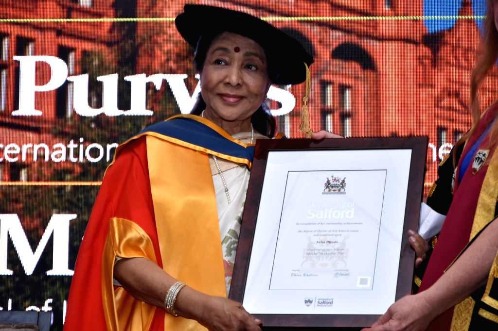Greater Manchester: Asha Bhosle receives Honorary Doctorate from the University of Salford in Greater Manchester, England on Oct 7, 2019. - Asha Bhosle