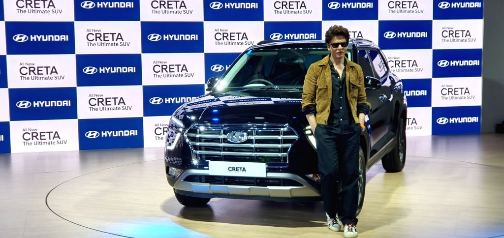 Greater Noida: Actor Shah Rukh Khan poses with the second-generation of Hyundai Creta launched on Day 2 of the Auto Expo 2020, in Greater Noida on Feb 6, 2020. - Shah Rukh Khan
