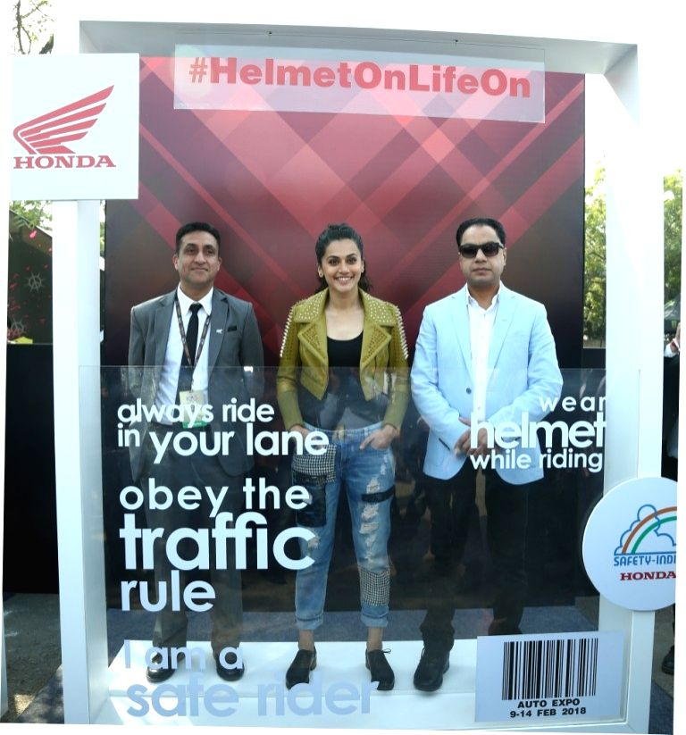 Greater Noida: Actress Taapsee Pannu launches #HelmetOnLifeOn Honda 2Wheelers India's Road Safety campaign at the Auto Expo 2018 in Greater Noida, Uttar Pradesh on Feb 10, 2018. - Taapsee Pannu