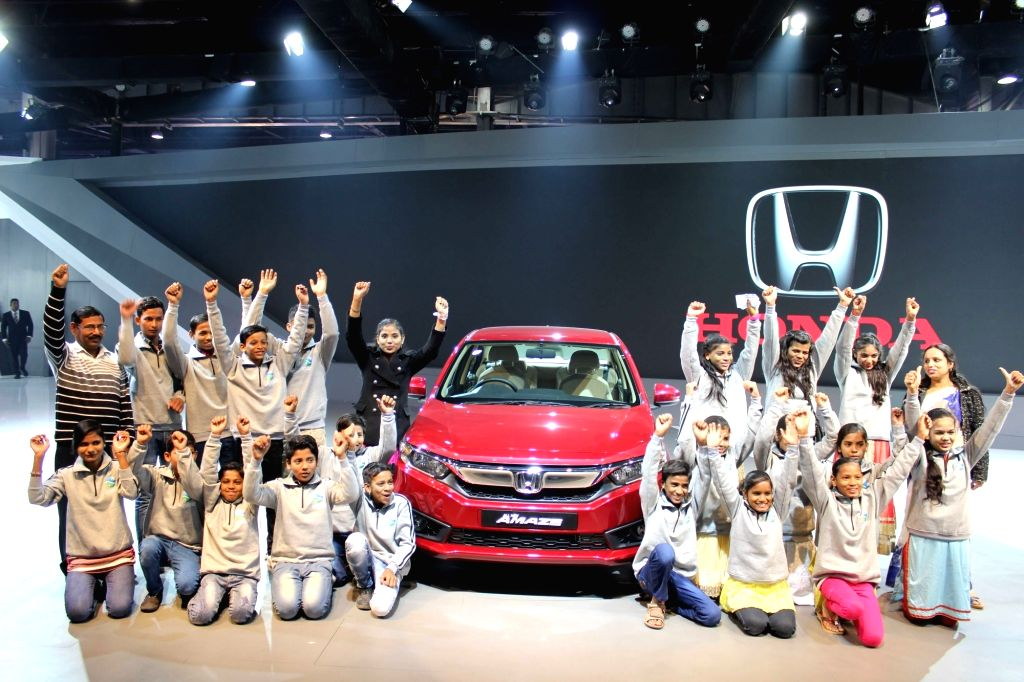 Greater Noida: Children from Deepalaya NGO visit Honda Cars stand at the Auto Expo 2018 in Greater Noida on Feb 12, 2018.