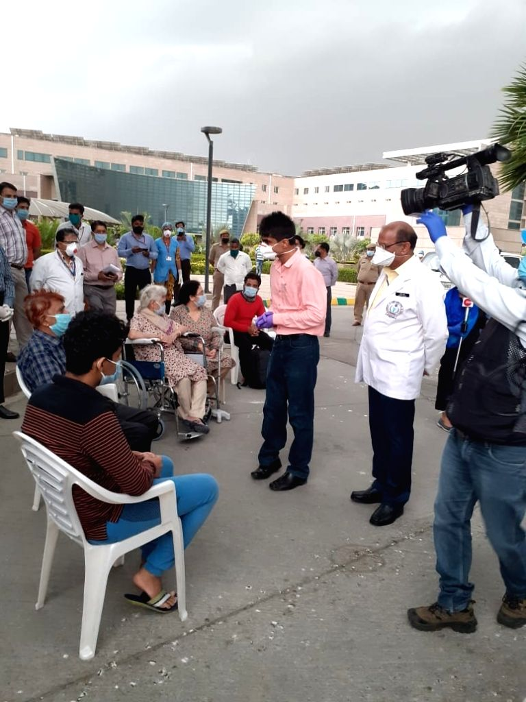 Greater Noida: Dictrict Magistrate gave certificates to patients who have recovered from Coronavirus and have been discharged by Government Institute of Medical Sciences (GIMS) in Greater Noida on ...