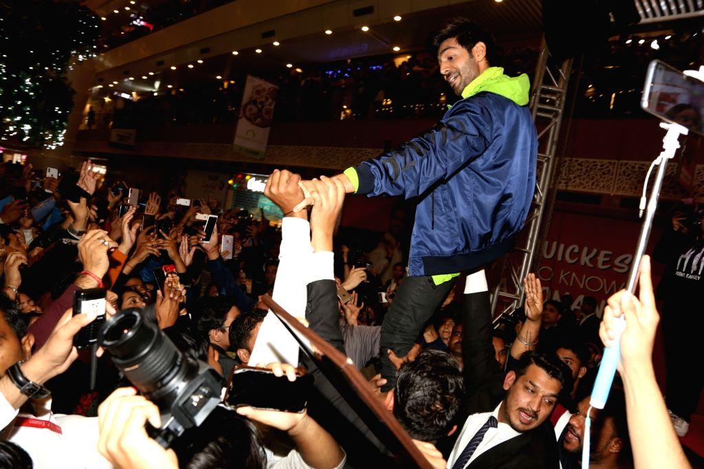 "Greater Noida: Greater Noida: Actor Kartik Aaryan during the promotion of his upcoming film ""Pati, Patni Aur Woh"" in Greater Noida, Uttar Pradesh on Dec 5, 2019. - Kartik Aaryan"