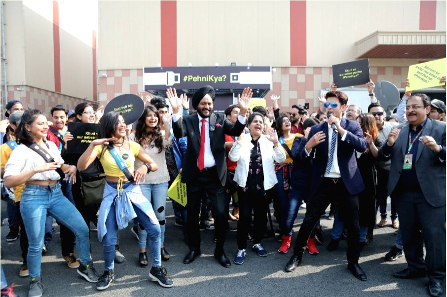 "Greater Noida: Maruti Suzuki's Senior Executive Director, Marketing and Sales RS Kalsi invites vehicle occupants to take the pledge and wear seatbelts during ""#PehniKya Flash Mob"" campaign ..."