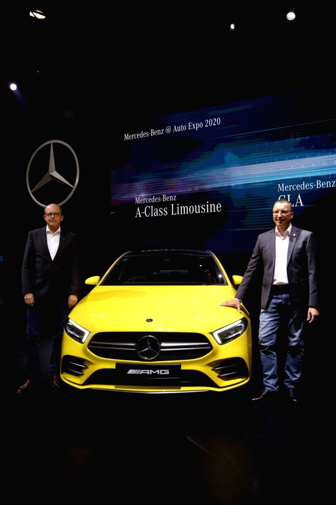 Greater Noida: Mercedes-Benz Head (Region Overseas) Matthias Luehers and Mercedes-Benz India MD and CEO Martin Schwenk with the New AMG A35 4M Limousine unveiled at the Auto Expo 2020 in Greater ...