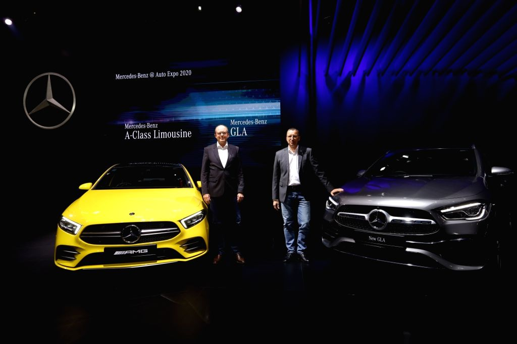 Greater Noida: Mercedes-Benz Head (Region Overseas) Matthias Luehers and Mercedes-Benz India MD and CEO Martin Schwenk with the New AMG A35 4M Limousine and the New GLA unveiled at the Auto Expo 2020 ...