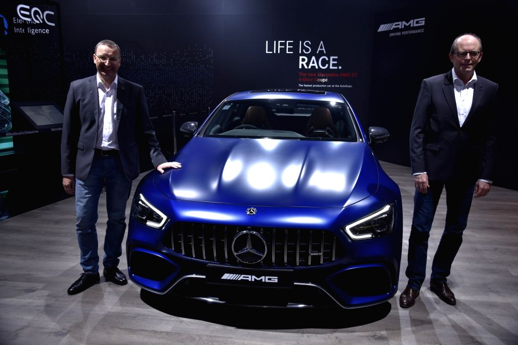 Greater Noida: Mercedes-Benz Head (Region Overseas) Matthias Luehers and Mercedes-Benz India MD and CEO Martin Schwenk with the New AMG GT 63 S 4 door coupe unveiled at the Auto Expo 2020 in Greater ...