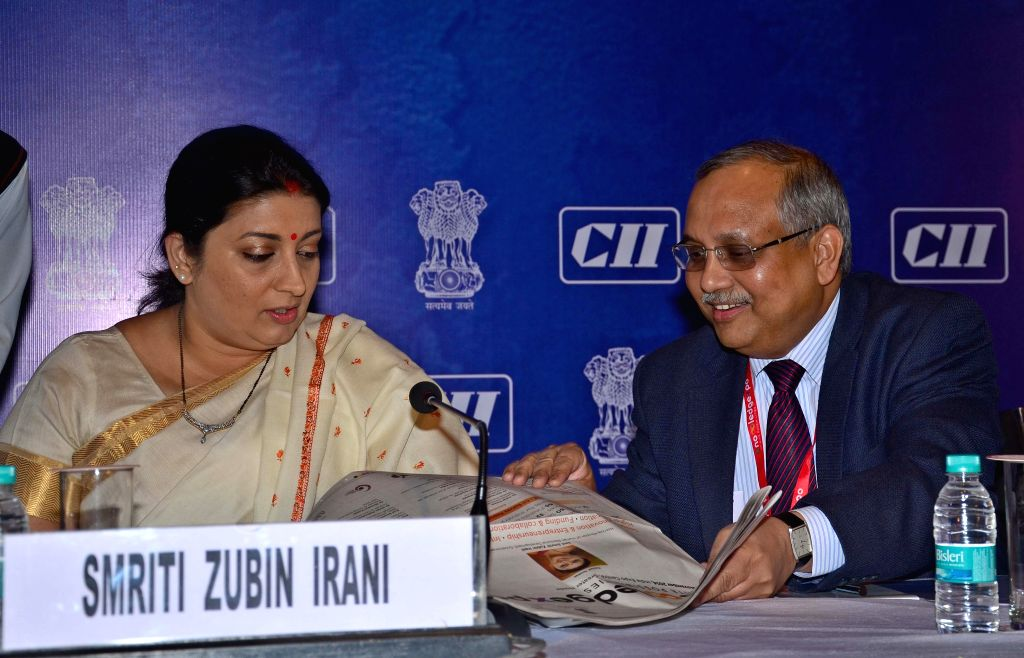 Greater Noida: Minister for Human Resource Development Smriti Irani releasing a AICTE-CII survey report on Industry linked Technical Institues-2014 at CII Knowledge Expo in Greater Noida, UP on Nov. .