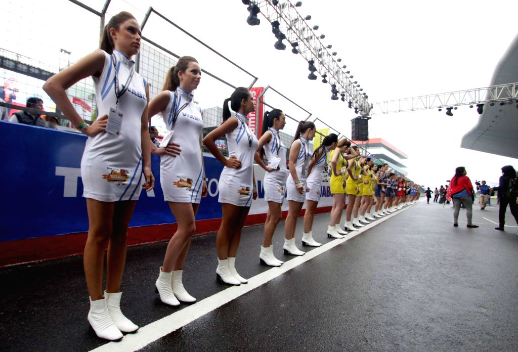 Greater Noida: Models at the Buddh International Circuit during the Season II of the T1 PRIMA Truck Racing Championship 2015 in Greater Noida on March 14, 2015.