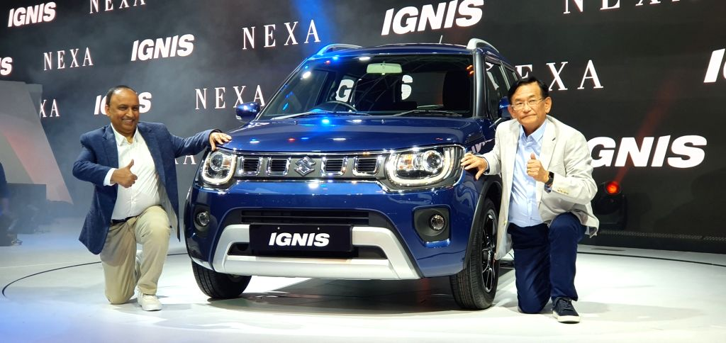 Greater Noida: MSIL Managing Director and CEO Kenichi Ayukawa and Maruti Suzuki India Executive Director (Marketing & Sales) Shashank Srivastava unveil the Ignis Facelift at the 2020 Auto Expo in ...