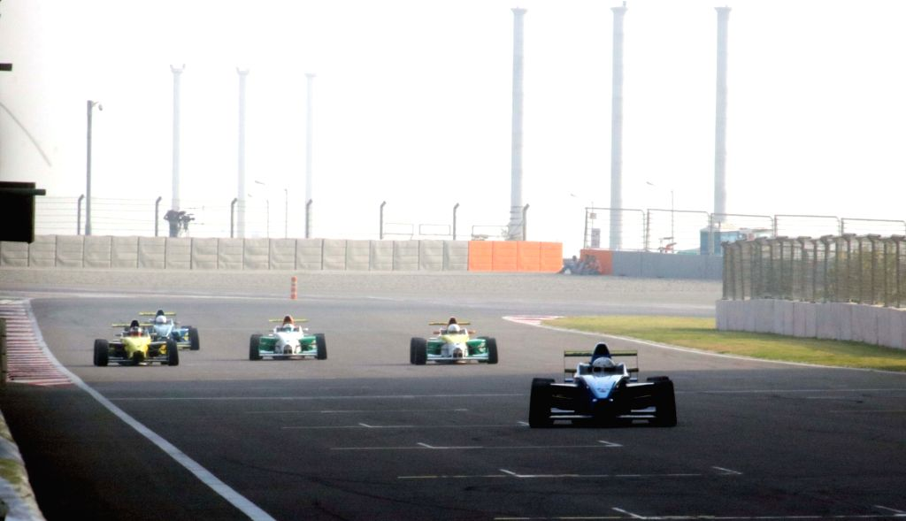 Greater Noida: Participants during the JK Tyre FMSCI National racing Championship 2016 at Buddh International Circuit (BIC) in Greater Noida on Nov. 20, 2016.