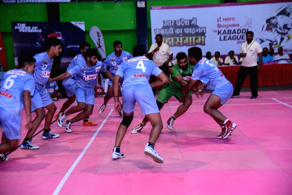 Greater Noida: Players in action during a UP Kabaddi League match between Muzaffarnagar Maharaja and Varanasi Volcano in Greater Noida on Oct 17, 2019.