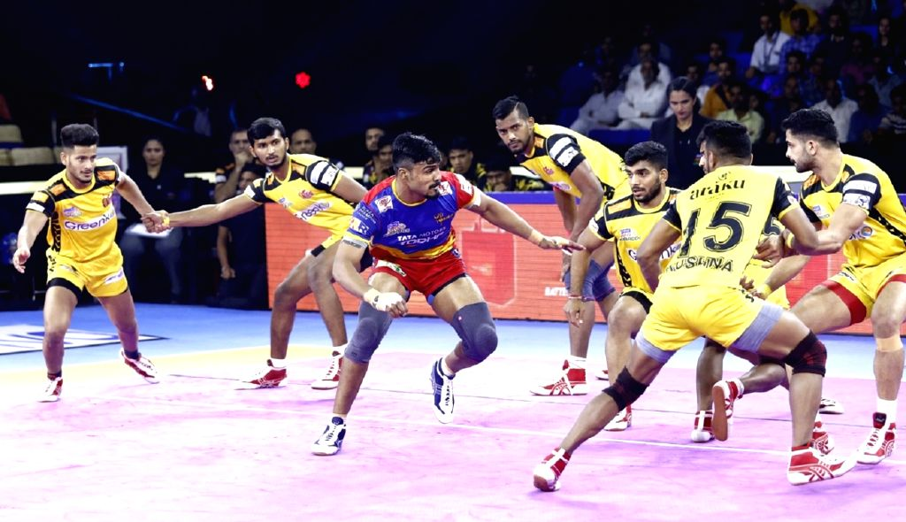 Greater Noida: Players in action during Pro Kabaddi Season 7 match between UP Yoddha and Telugu Titans at Shaheed Vijay Singh Pathik Sports Complex, Greater Noida on Oct 9, 2019.