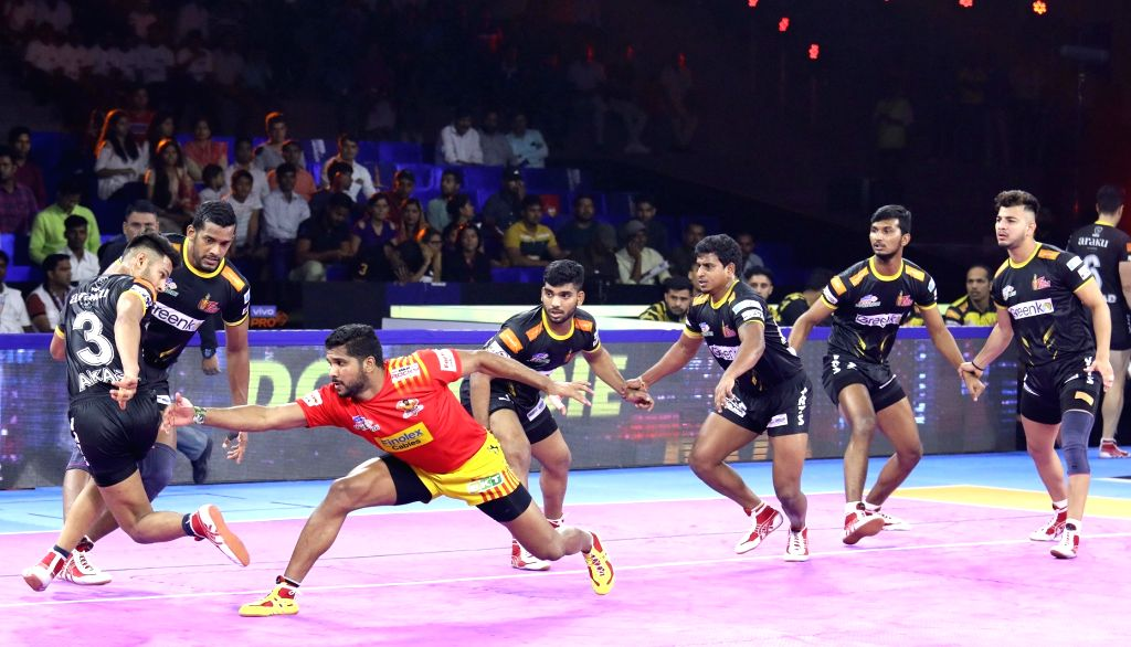Greater Noida: Players in action during Pro Kabaddi Season 7 match between Telugu Titans and Gujarat Fortunegiants at Shaheed Vijay Singh Pathik Sports Complex, Greater Noida on Oct 7, 2019. (Photo: IANS)