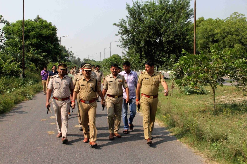 Greater Noida: Policemen after a gunfight with criminals in Greater Noida on Oct 10, 2017.