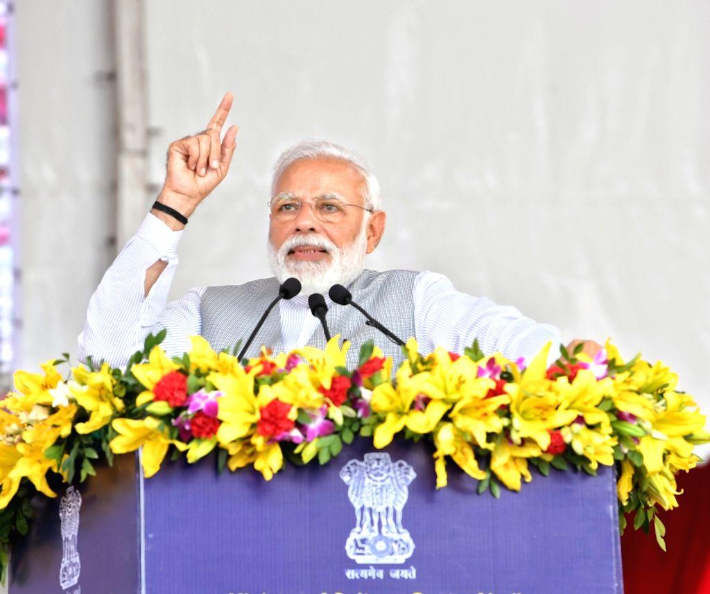 Greater Noida: Prime Minister Narendra Modi addresses during a programme at Greater Noida, Uttar Pradesh on March 9, 2019. - Narendra Modi