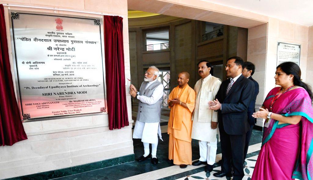 Greater Noida: Prime Minister Narendra Modi inaugurates Pandit Deendayal Upadhyaya Institute of Archaeology, at Greater Noida, Uttar Pradesh on March 9, 2019. Also seen Uttar Pradesh Chief Minister ... - Narendra Modi and Mahesh Sharma