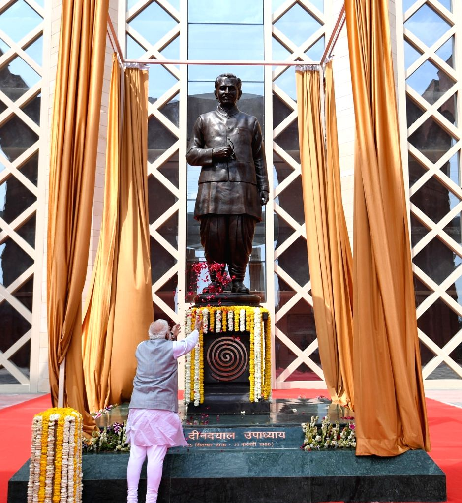 Greater Noida: Prime Minister Narendra Modi pays floral tributes at the statue of Pandit Deendayal Upadhyaya, during inauguration of the Pandit Deendayal Upadhyaya Institute of Archaeology at Greater ... - Narendra Modi