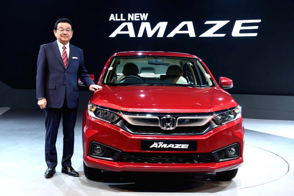Greater Noida: Takahiro Hachigo, President & Representative Director, Honda Motor Co., Ltd at the global unveiling of next generation Honda Amaze at Auto Expo 2018 in Greater Noida on Feb. 7, ...