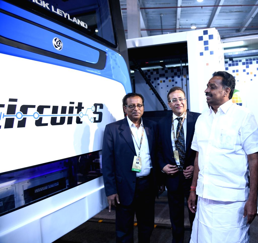 Greater Noida: Tamil Nadu Transport Minister Vijaya Baskar with Ashok Leyland's Circuit-S Electric Bus at the Auto Expo 2018 in Greater Noida, Uttar Pradesh on Feb 9, 2018. - Vijaya Baskar