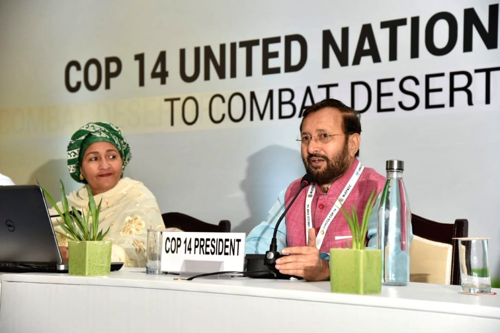 Greater Noida: Union Environment, Forest and Climate Change and Information and Broadcasting Minister Prakash Javadekar addresses a press conference at the 14th Conference of Parties (COP14) to ... - Prakash Javadekar