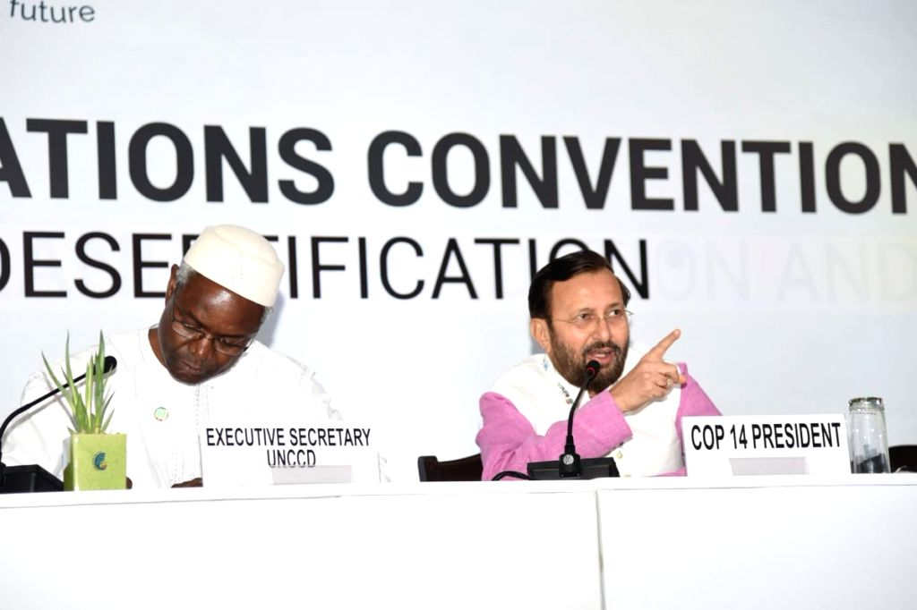 Greater Noida: Union Environment, Forest and Climate Change and Information and Broadcasting Minister Prakash Javadekar accompanied by United Nations Convention to Combat Desertification (UNCCD) Executive Secretary Ibrahim Thiaw, addresses a press co - Prakash Javadekar