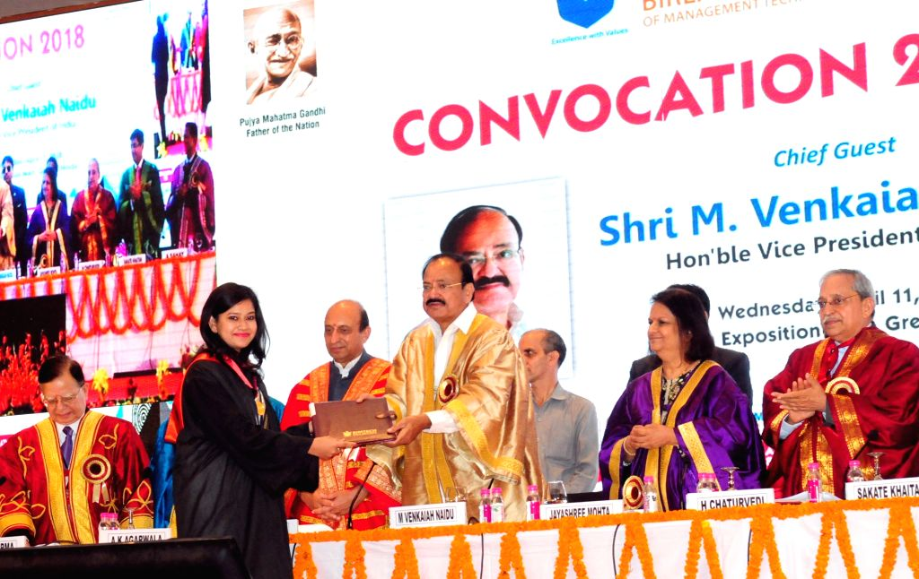 Greater Noida: Vice President M. Venkaiah Naidu presents degree to a student, at Birla Institute of Management and Technology (BIMTECH) Annual Convocation 2018, in Greater Noida, Uttar Pradesh on ... - M. Venkaiah Naidu