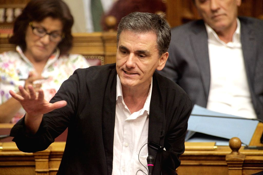 Greek Finance Minister Euclid Tsakalotos speaks in a parliament debate in Athens, Greece, Aug. 14, 2015. The Greek Parliament on Friday ratified the country's third ... - Euclid Tsakalotos