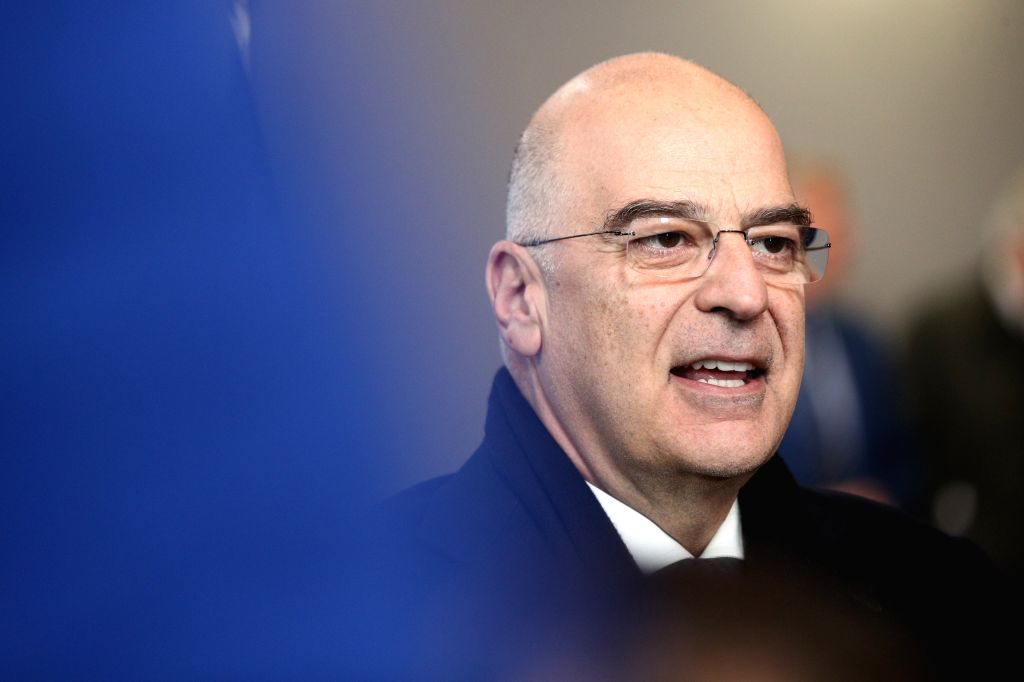 Greek Foreign Minister Nikos Dendias speaks to journalists as he arrives for an EU foreign ministers' meeting at the EU headquarters in Brussels, Belgium, Jan. 10, ... - Nikos Dendias