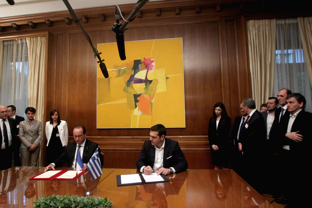 Greek Prime Minister Alexis Tsipras (central R) and French President Francois Hollande (central L) attend a ceremony to sign an agreement of bilateral cooperation at ... - Alexis Tsipras