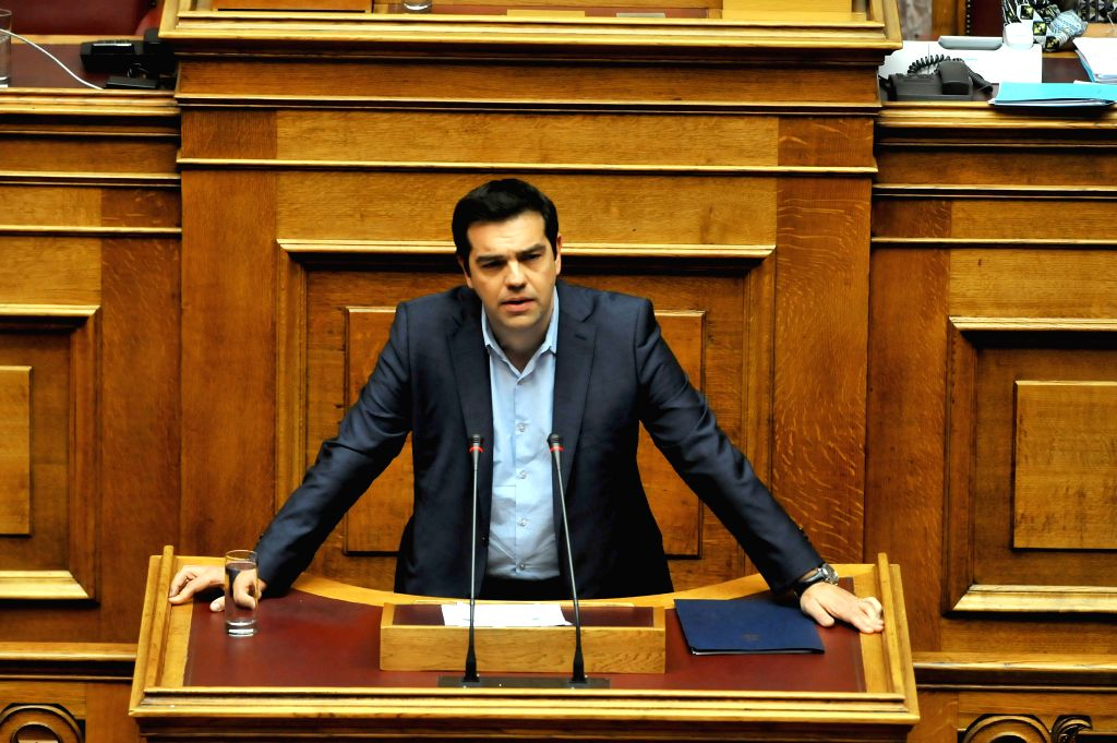 Greek Prime Minister Alexis Tsipras delivers a speech during an emergency parliament session in Athens, July 23, 2015. Greek lawmakers launched a late-night debate ... - Alexis Tsipras