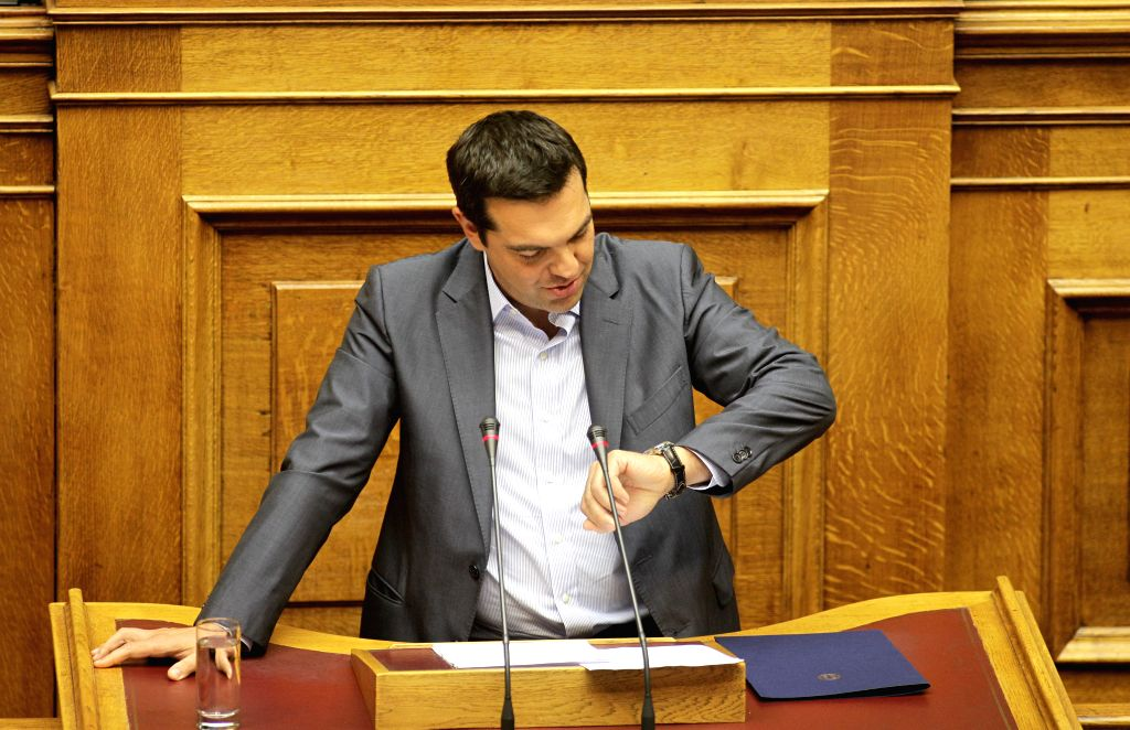 Greek Prime Minister Alexis Tsipras gives a speech before the roll call vote in the parliament in Athens, Greece, Aug. 14, 2015. The Greek Parliament on Friday ... - Alexis Tsipras