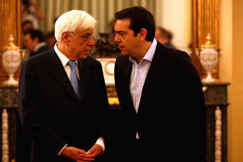 Greek Prime Minister Alexis Tsipras (R) talks with Greek President Prokopis Pavlopoulos (L) during a swearing in ceremony of new cabinet members at the Presidential ... - Alexis Tsipras