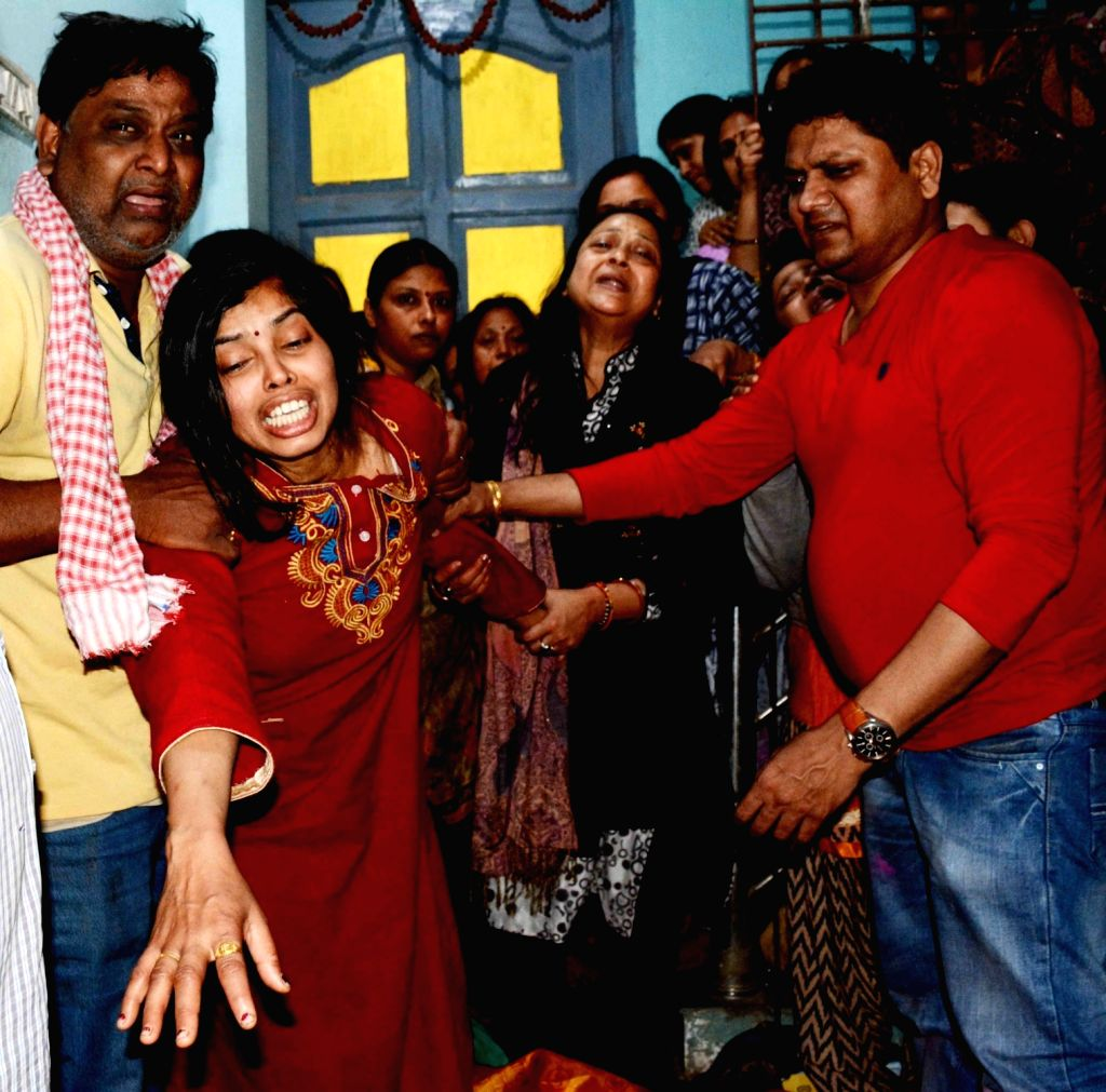 Grief struck family members of cake shop owner Purushotttam Kumar who was shot dead by unidentified bike-borne armed criminals after he tried to resist attempt to loot a bag filled with hefty ... - Purushotttam Kumar