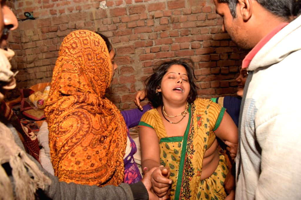 Grief struck Reema Yadav, wife of Ramesh Yadav one of the 45 CRPF personnel killed in a suicide attack by militants in Jammu and Kashmir's Pulwama district on 14th Feb 2019; in Tofapur ... - Reema Yadav and Ramesh Yadav
