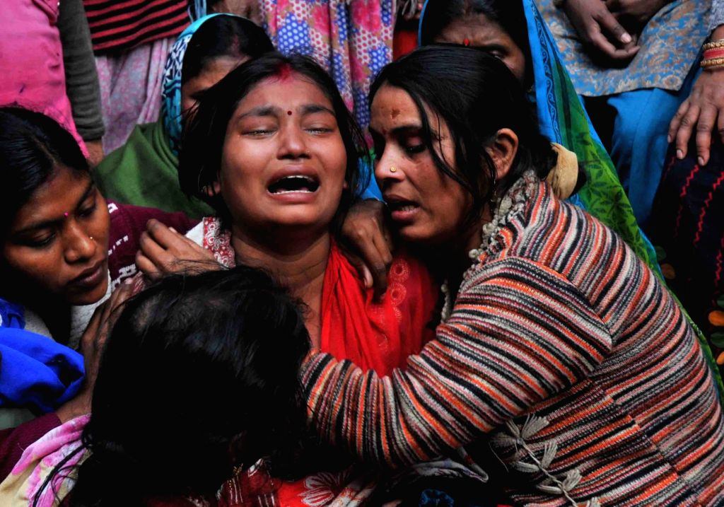 Grief struck relatives of those killed in Bawana factory fire in New Delhi on Jan 21, 2018. As many as 17 people, including 10 women, were burnt to death or asphyxiated and 30 others ...