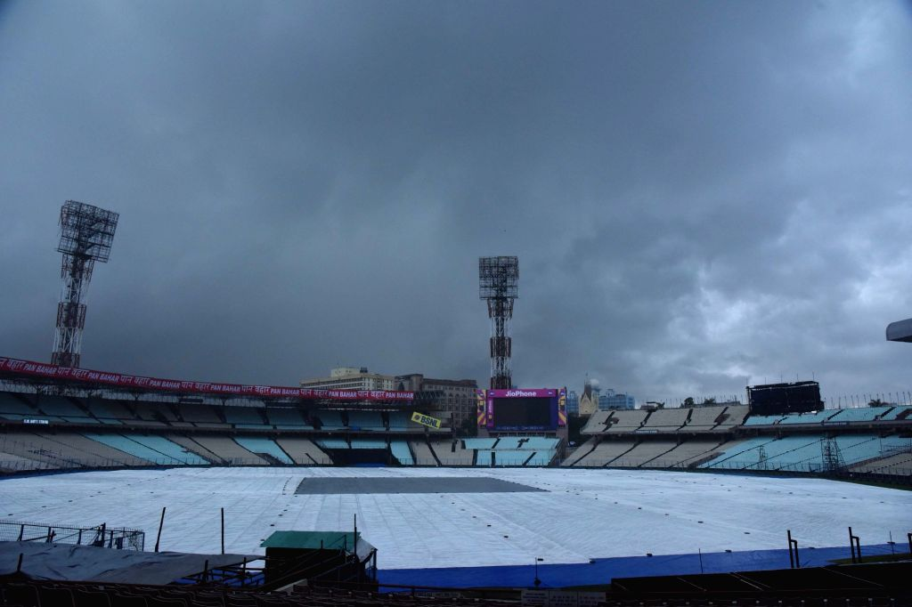 Ground covered with plastic sheets during rains ahead of the 2nd ODI match between India and Australia, at the Eden Gardens Cricket stadium in Kolkata on Sept 19, 2017.