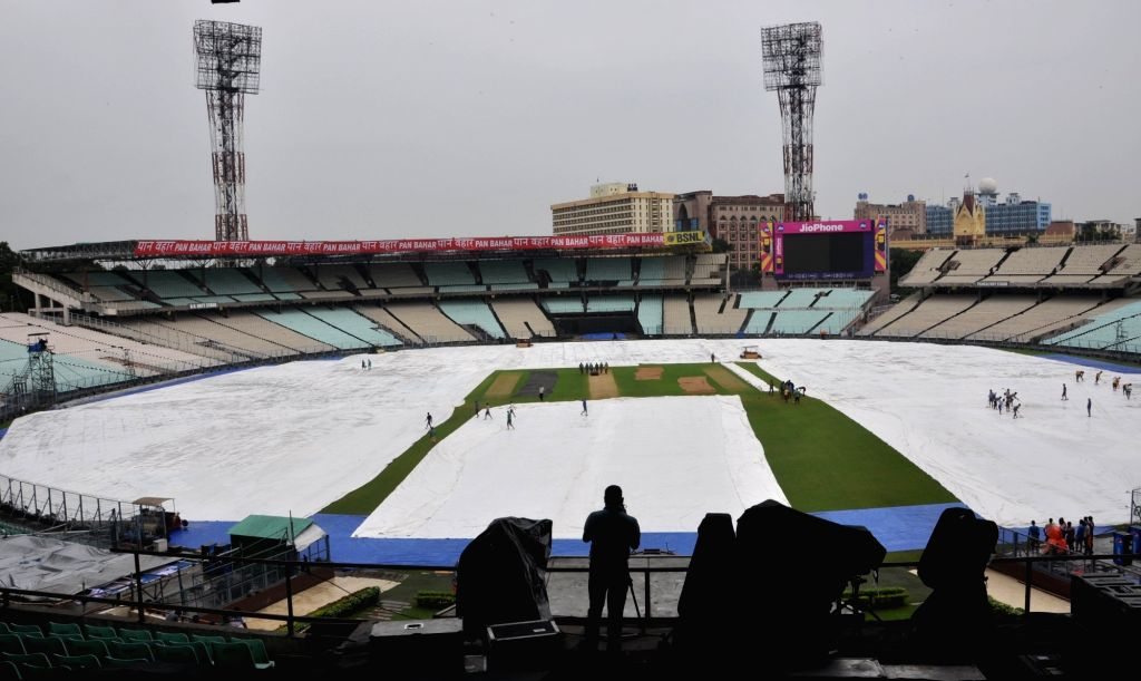 Ground staff carries out maintenance work during rains ahead of the 2nd ODI match between India and Australia at the Eden Gardens Cricket stadium in Kolkata on Sep 20, 2017.