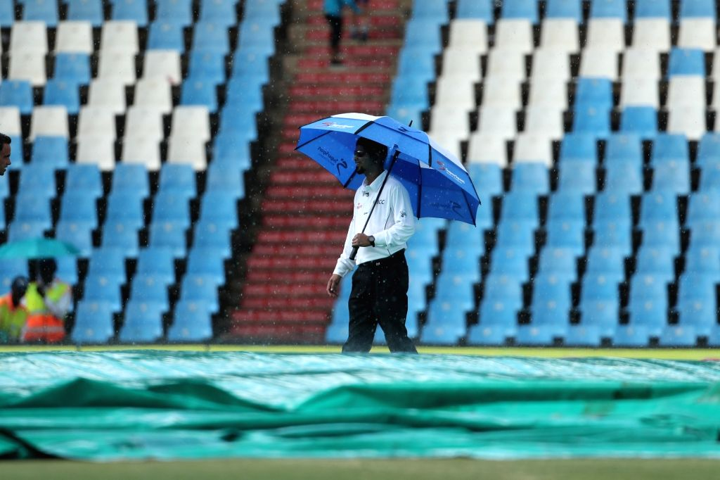 Groundsmen cover the ground with tarpaulin sheets as rain delay day 3 of the second Test match between South Africa and India at the Supersport Park Cricket Ground in Centurion, South ...