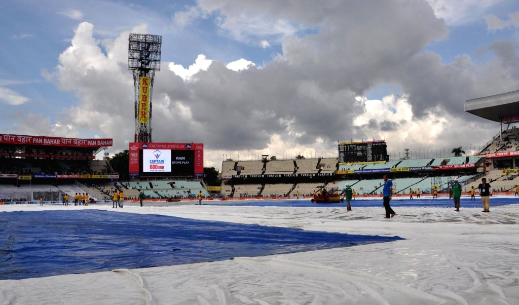 Groundsmen cover the pitch as rains disrupt on Day 2 of the Second Test Match between India and New Zealand at Eden Gardens in Kolkata on Oct 1, 2016.