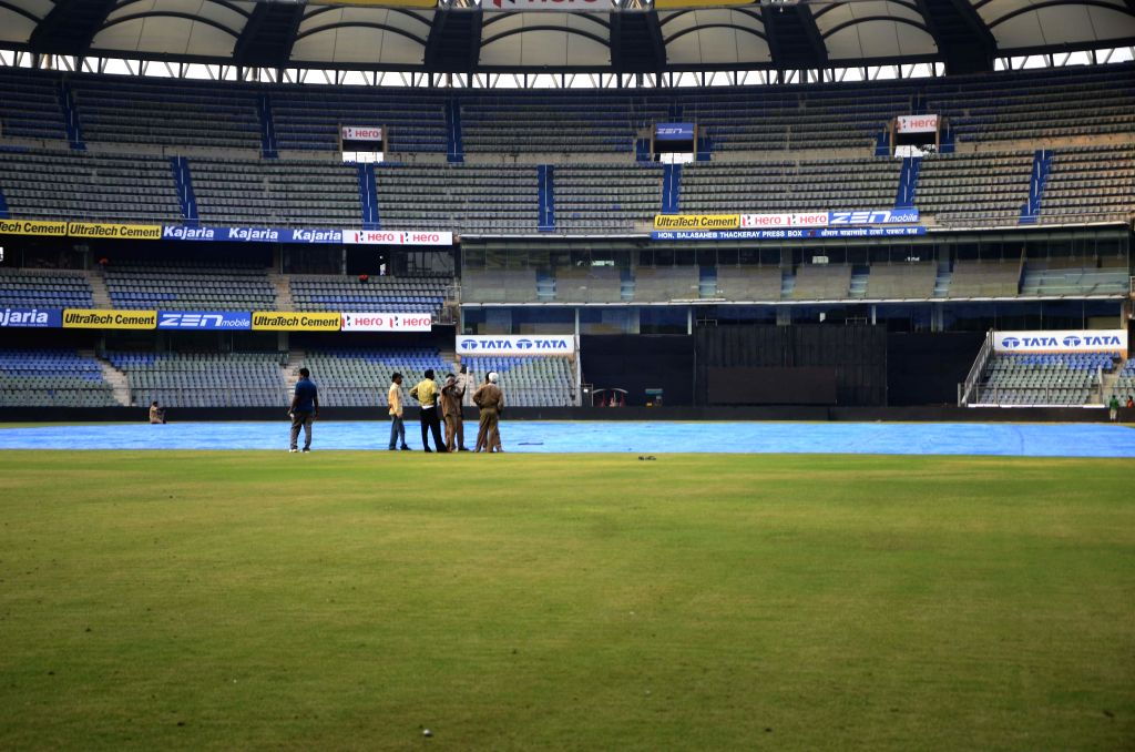 Groundsmen prepare the field ahead of the 5th ODI between India and South Africa at Wankhede Stadium in Mumbai, on Oct 23, 2015.