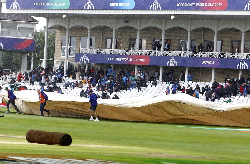Groundsmen pull on the covers as rain delayed the start of the 18th Match of World Cup 2019 between India and New Zealand at Trent Bridge in Nottingham, England on June 13, 2019.