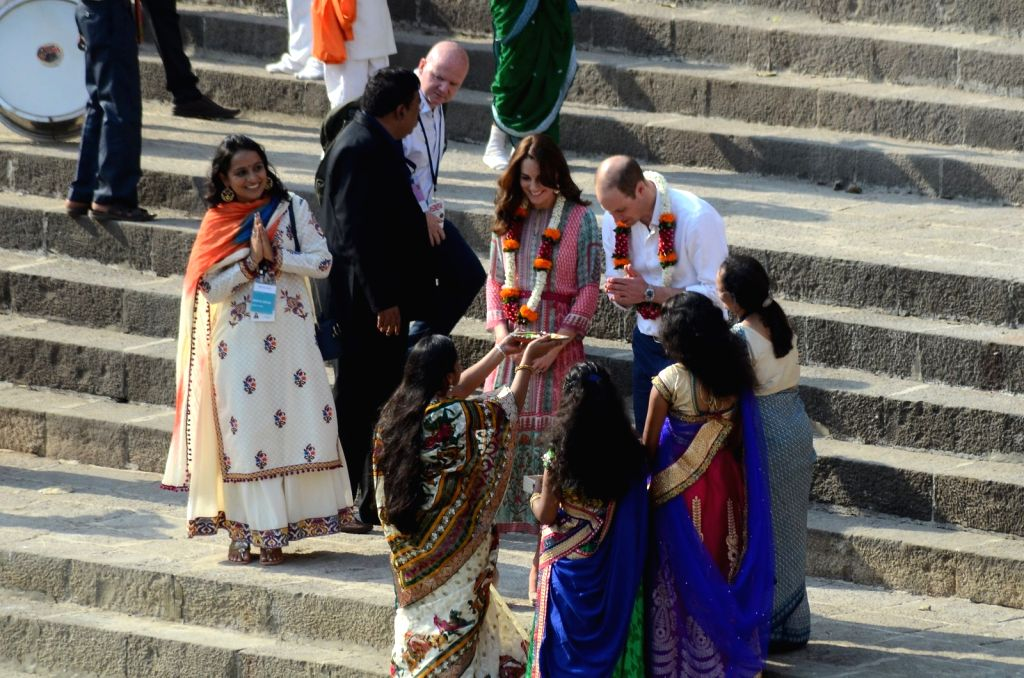 Group of woman give a tradition welcome to Britain's Prince William along with wife Kate, the Duchess of Cambridge during their visit to Banganga tank in Mumbai, on April 10, 2016.