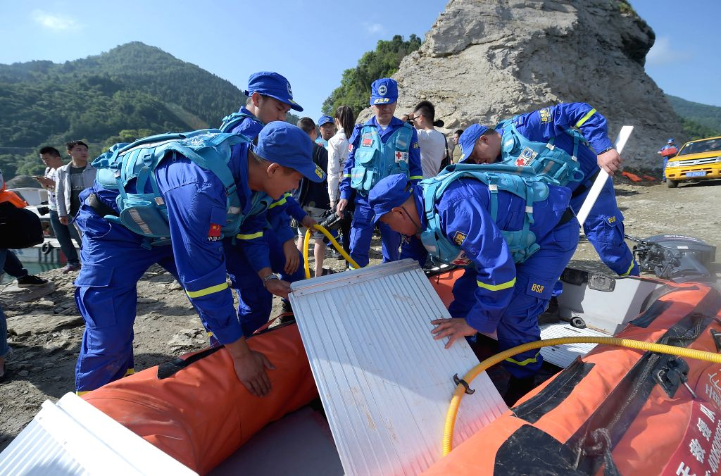 GUANGYUAN, June 5, 2016 - Rescuers prepare to head for the accident site to search for missing people in Bailong Lake of Guangyuan, southwest China's Sichuan Province, June 5, 2016. A leisure boat ...