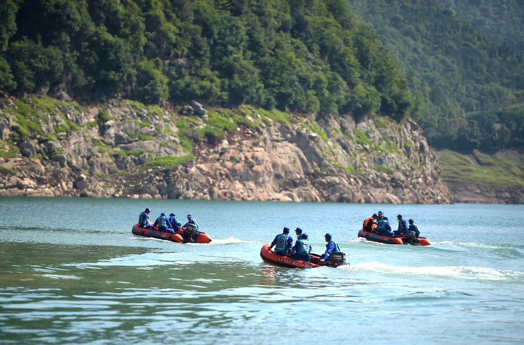 GUANGYUAN, June 5, 2016 - Rescuers search for missing people in Bailong Lake of Guangyuan, southwest China's Sichuan Province, June 5, 2016. A leisure boat carrying 18 people capsized on the Lake due ...