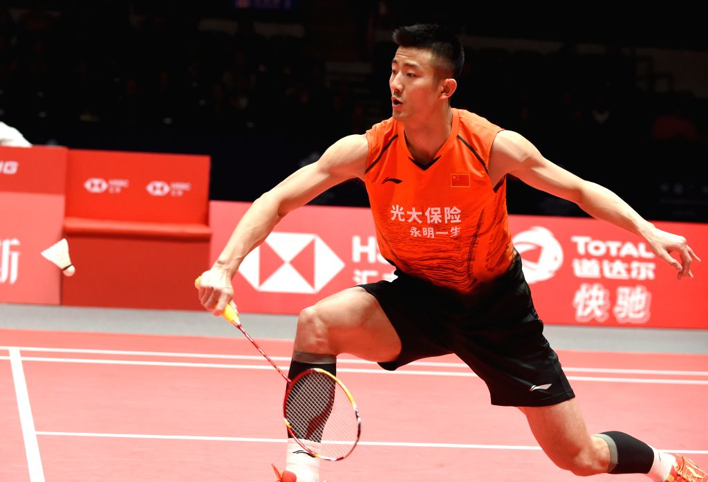 GUANGZHOU, Dec. 11, 2019 - China's Chen Long hits a return during the men's singles group B match between China's Chen Long and Denmark's Viktor Axelsen at the BWF World Tour Finals 2019 in ...