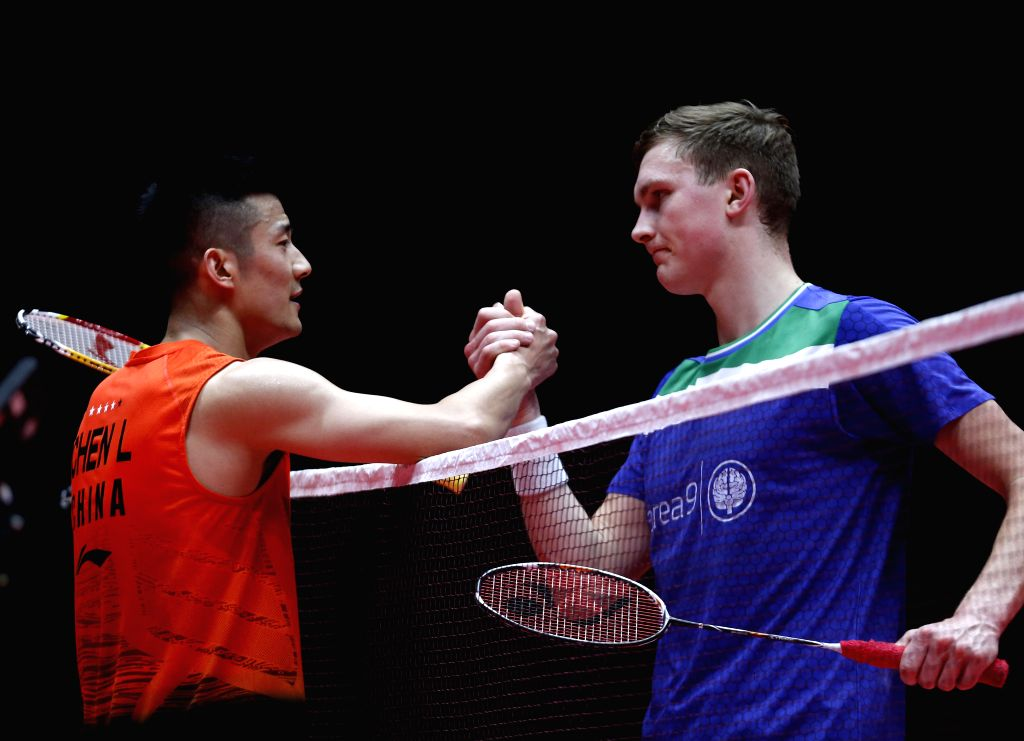 GUANGZHOU, Dec. 11, 2019 - China's Chen Long (L) shakes hands with Denmark's Viktor Axelsen after their men's singles group B match at the BWF World Tour Finals 2019 in Guangzhou, capital of south ...