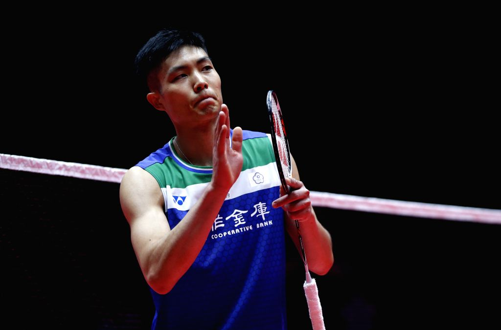 GUANGZHOU, Dec. 11, 2019 - Chou Tien Chen of Chinese Taipei celebrates after beating Indonesia's Anthony Sinisuka Ginting during the men's singles Group B match at BWF World Tour Finals 2019 in ...