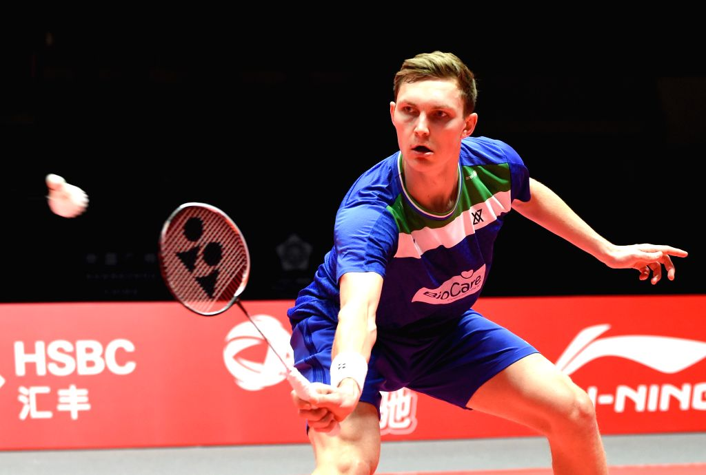 GUANGZHOU, Dec. 11, 2019 - Denmark's Viktor Axelsen hits a return during the men's singles group B match between China's Chen Long and Denmark's Viktor Axelsen at the BWF World Tour Finals 2019 in ...