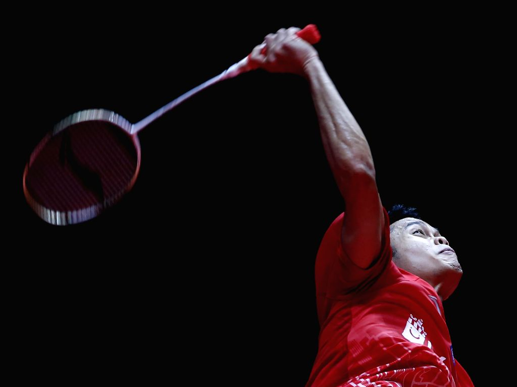 GUANGZHOU, Dec. 11, 2019 - Indonesia's Anthony Sinisuka Ginting hits a return to Chou Tien Chen of Chinese Taipei during the men's singles Group B match at BWF World Tour Finals 2019 in Guangzhou, ...